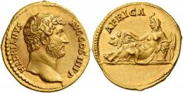 61  -  HADRIAN AUGUSTUS. Aureus. AV 7.13 g. HADRIANVS – AVG COS III P P Bare head r. Rev. AFRICA Africa with elephant-skin headdress, reclining l., resting r. hand on lion and l. arm on basket; behind basket, corn ears. Very rare and in exceptional condition for this fascinating issue, undoubtedly one of the finest specimens in private hands. A wonderful portrait of fine sytle and a magnificent reverse composition. Good extremely fine.