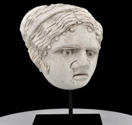 36  -  CABEZA PALMIRA. ESTUCO. SIGLO II D.C.