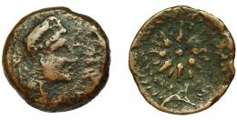 2052  -  HISPANIA ANTIGUA. MALAKA. Unidad. A/ Cabeza de Vulcano con bonete a der., detrás mlk' y tenazas. R/ Estrella de dieciséis puntas con glóbulo central. AE 5,5 g. 20,9 mm. I-1734. ACIP-803. BC-/BC+. Muy rara.