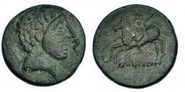8  -  Unidad. Ikalesken. A/ Cabeza masculina a der; delante, delfín. I-1409. Pátina verde. MBC-.