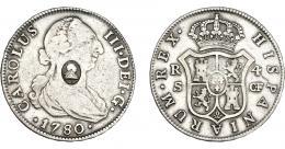 1014  -  COLECCIÓN DE RESELLOS. GRAN BRETAÑA. 1/2 dólar. Resello busto de Jorge III dentro de óvalo sobre 4 reales 1780 Sevilla CF. KM-622.2. MBC.