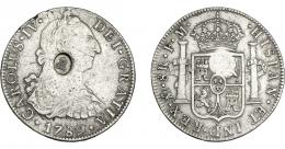 1016  -  COLECCIÓN DE RESELLOS. GRAN BRETAÑA. Dólar. Resello busto de Jorge III dentro de óvalo sobre 8 reales 1789 México FM. KM-625. MBC.