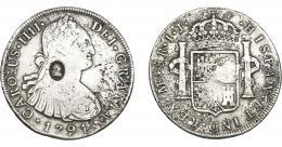 1018  -  COLECCIÓN DE RESELLOS. GRAN BRETAÑA. Dólar. Resello busto de Jorge III dentro de óvalo sobre 8 reales 1791 Lima IJ. KM-638. La moneda BC+, con oxidaciones marinas, el resello MBC.
