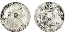 1019  -  COLECCIÓN DE RESELLOS. GRAN BRETAÑA. Dólar. Resello busto de Jorge III dentro de óvalo sobre 8 reales 1792 México FM. KM-634. La moneda MBC-, el resello MBC+.