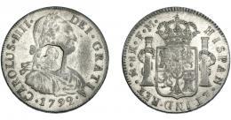 1025  -  COLECCIÓN DE RESELLOS. GRAN BRETAÑA. Dólar. Resello busto de Jorge III dentro de punzón octogonal sobre 8 reales 1792 México FM, falso de época en metal blanco. El resello, auténtico. KM-no. MBC.