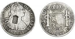 1056  -  COLECCIÓN DE RESELLOS. PORTUGAL. 870 reis. Resello escudo de Portugal sobre 8 reales 1804 México TH. KM-440.13. Gomes-27.37. La moneda BC+, el resello MBC.