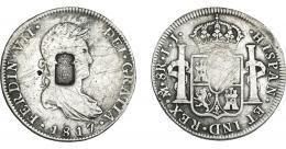 1068  -  COLECCIÓN DE RESELLOS. PORTUGAL. 870 reis. Resello escudo de Portugal sobre 8 reales 1817 México JJ. KM-440.15. Gomes-29.38. Rayas. La moneda BC+, el resello MBC.