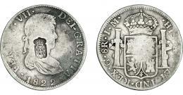 1074  -  COLECCIÓN DE RESELLOS. PORTUGAL. 870 reis. Resello escudo de Portugal sobre 8 reales 1822. Guanajuato JM. KM-440.18. Gomes-29.62. La moneda BC+, el resello MBC.