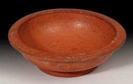 2028  -  ARQUEOLOGÍA. ROMA. Imperio Romano. Cuenco (siglo II-III d.C.). Terra Sigillata. Altura 3,4 cm. Diámetro 11,7 cm.
