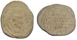 281  -  HISPANIA ANTIGUA. TURRIREGINA. Plomo monetiforme. A/ Cabeza con casco a der., alrededor gráfila de hiedra. R/ Falcata y rodela, en medio ley. entre líneas TVRRIRICINA/t´lsurkn. Pb 21,73 g, 35 mm. CCP-no. BC+.