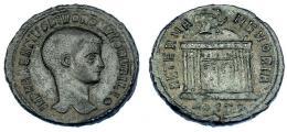 228  -  IMPERIO ROMANO. RÓMULO (hijo de Majencio). Follis. Acuñación póstuma. Ostia (309-312). A/ Cabeza a der.; IMP MAXENTIVS DIVO ROMVLO N V FILIO. R/ Templo con cúpula rematada en águila; exergo HOSTP; AETERNA MEMORIA. AE 6,23 g. 25,5 mm. RIC-33. Rara. MBC.