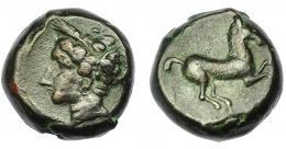 75  -  GRECIA ANTIGUA. SICILIA. Acuñaciones sículo-púnicas. AE (375-350 a.C.). A/ Cabeza de Tanit a izq. R/ Caballo cabalgando a der. AE 5,85g. 15,21 mm. COP-97. MBc.
